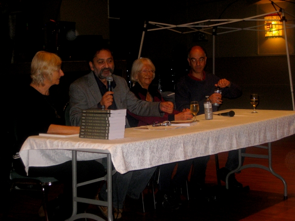 Gloria M. Allan (second from right), answered questions about her book, A Walk on Broken Glass, at the Budapest Coffeehouse.